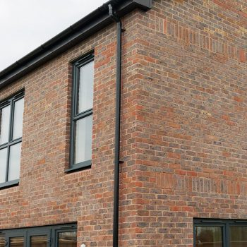 Black tilt and turn uPVC windows