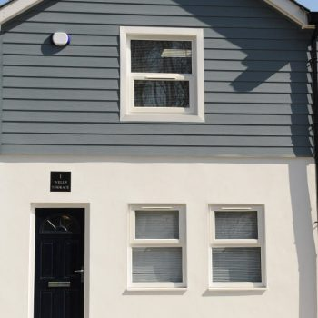 Casement windows and blue external cladding