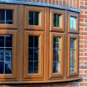 Golden oak uPVC bow window