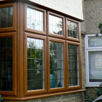 Golden oak uPVC leaded bay window