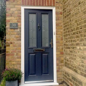 Grey composite door with silver handle and additional hardware