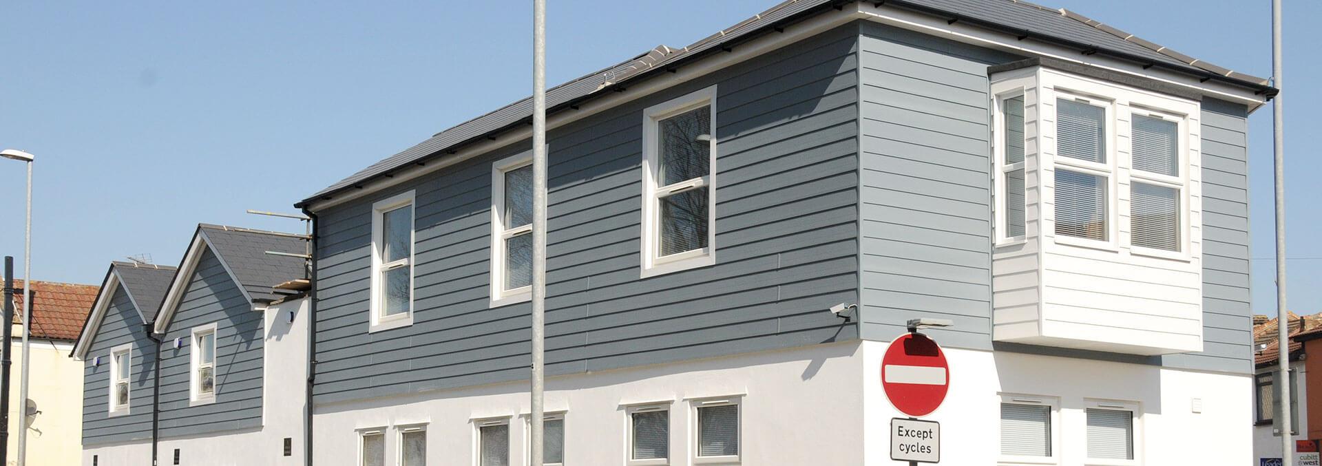 Light blue external cladding installation