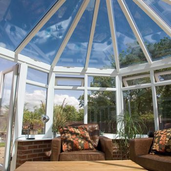 White uPVC victorian conservatory interior with a glass roof