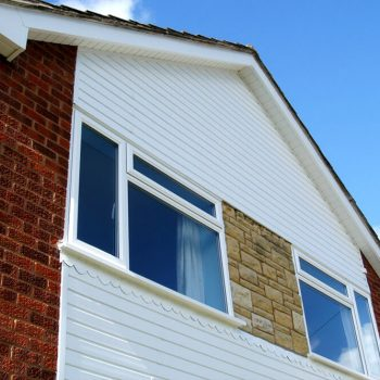 White uPVC casement windows with external cladding