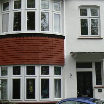 Bay and casement style uPVC windows in white