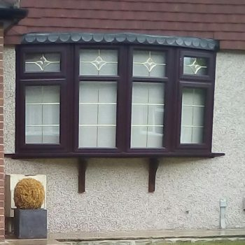 Black uPVC windows in bow style