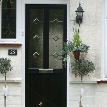 Black composite door with decorative glass