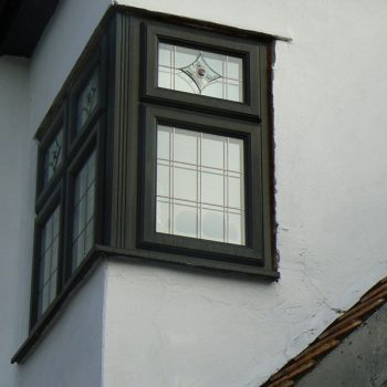 Black corner windows with lead detail and decorative windows