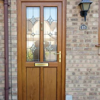 Brown upvc entrance door with glass panels