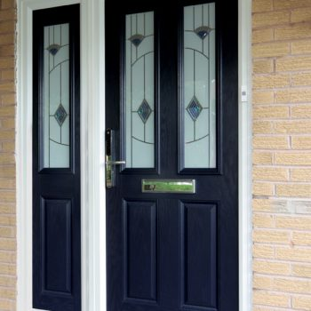 Black composite door with decorative glass and gold hardware