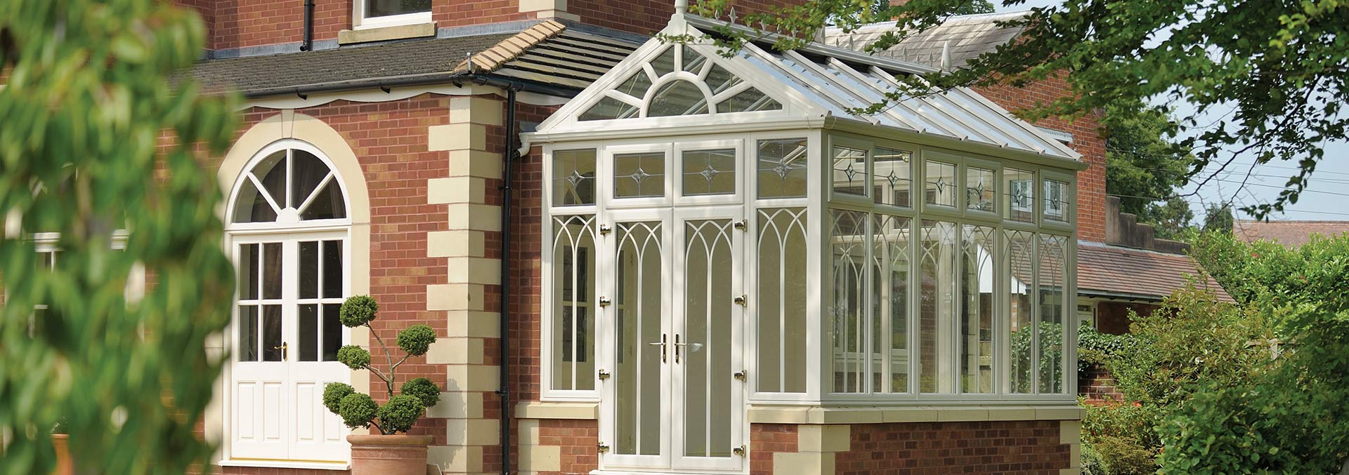 Custom made conservatory in uPVC with gable front roof