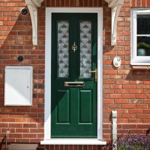 Front entrance door with glazed panels in dark green