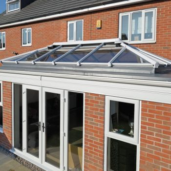 Red brick orangery installation with glass roof