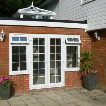 Orangery with uPVC french doors and brick structure