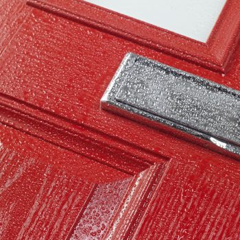 Red composite door with woodgrain effect outer skin