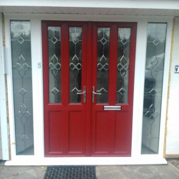 Red double entrance doors with side panels
