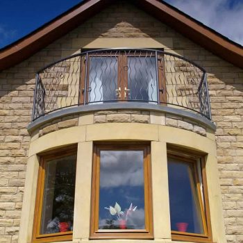 Brown upvc windows with reversible functionality