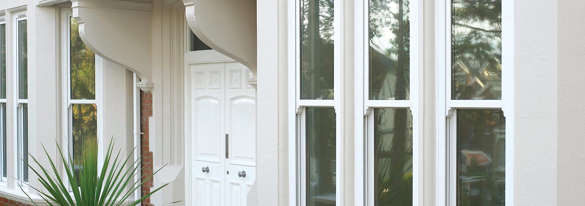 uPVC sliding sash windows in white