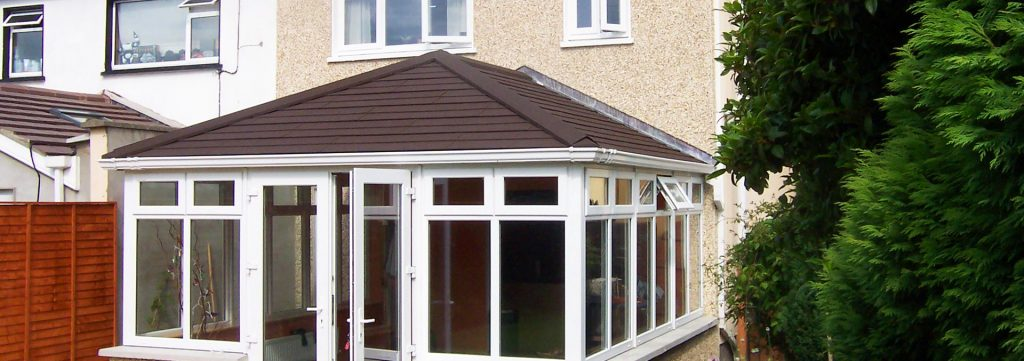 Tiled conservatory roof which replaced old polycarbonate conservatory roof