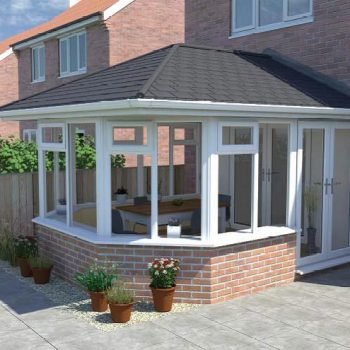 A victorian shape conservatory design with tiled warm roof solution