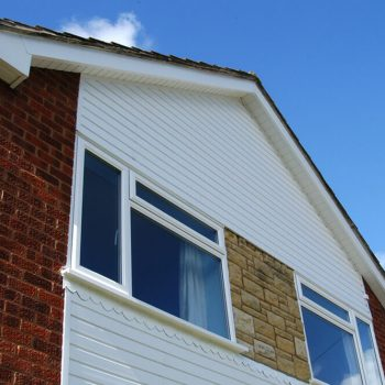 White uPVC casement window and external cladding & soffits