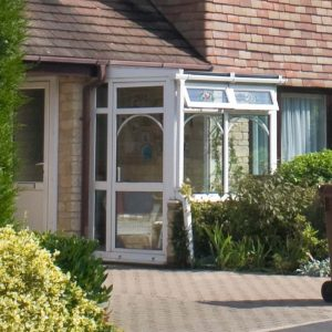 White uPVC porch leading to front entrance door