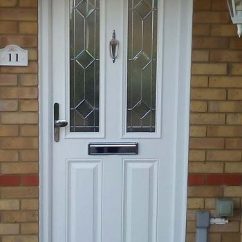 White composite door with chrome hardware