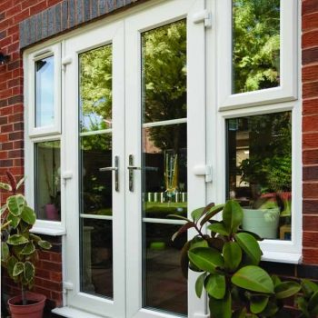 White uPVC french doors with side casement windows
