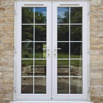 White uPVC double french door with astragal bars