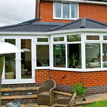 Black tiled warmroof on a uPVC conservatory
