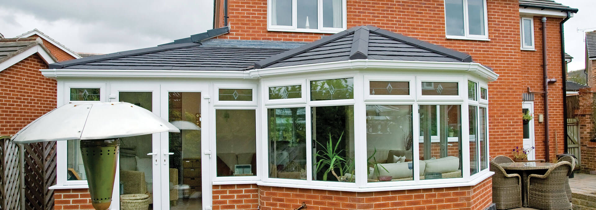 P Shaped conservatory with a grey tiled roof