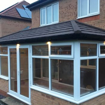 New conservatory with tiled warm roof
